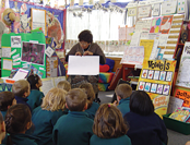 image of classroom and teacher teaching.