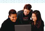 Three students sitting at a computer.