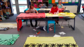 Students painting a lavalava.